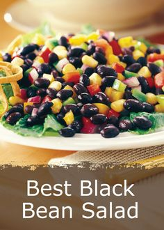 This colorful Black Bean Salad is dressed with a zesty lime vinaigrette and only takes a few minutes to prepare. Serve with tortilla chips or as a side dish!