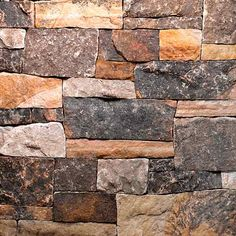 all about stone veneer charles luck cubist-style multi-colored fieldstone.  OUTSIDE STONE?