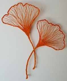 Meredith Woolnough: Two Ginko Leaves (2012) embroidery thread, pins, glass rods on fabriano paper