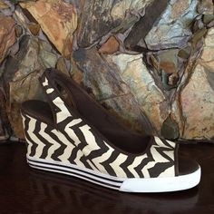 """Authentic Coach Sydney Zebra wedges new with original box. Authentic Coach Sydney zebra wedges. Color: brown/cream. Style: A0158. Sneaker like rubber sole makes these shoes extremely comfortable to wear. Never worn but there are Some minor scuffs on sole (see photo) Size: 10. Heel: 3-1/2"""" Coach Shoes Wedges"""