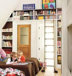 Bookshelves installed on an unused wall take advantage of the high ceilings in this kids' bunk room. | myhomeideas.com