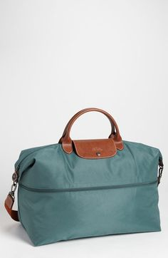 Free shipping and returns on Longchamp 'Le Pliage' Expandable Travel Bag at Nordstrom.com. A zip inset expands and contracts a durable, water-resistant nylon travel bag trimmed with rich brown leather.
