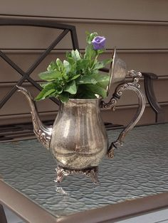 Re-purposed old silver coffee or tea pots.  Drill hole in bottom for drainage.