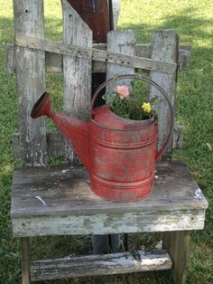 Old Watering Can...on a rustic bench.