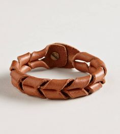Leather bracelet-flipped onto itself...MXS                                                                                                                                                     More