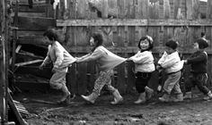 Children playing. 1960, Misawa, Japan. Photographer Thomas Roach