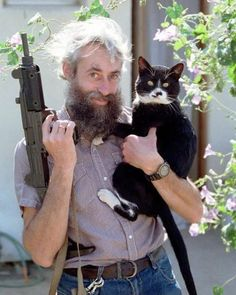 """""""Oh hey! Didn't see you there... Just hanging out with my cat and my machine gun. You know.. Chillin."""""""