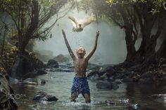 Feeling Fresh - Asia, The boy with white duck feeling the midst of nature.