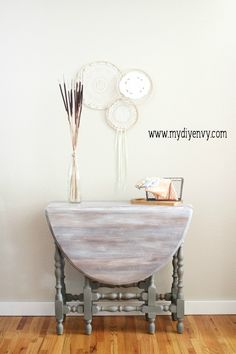 This table makeover features a dry brushed, then whitewashed table top and painted legs. Love this gate leg whitewashed table makeover! | www.mydiyenvy.com