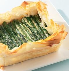Asparagus Cheese Tart ღ   4 sheets phyllo pastry, olive oil, 1 cup/ 250g ricotta, ½ cup/ 125g low fat cottage cheese, 1 crushed clove garlic, 14 oz/ 400g green asparagus spears, olive oil, ¼-½ cup grated parmesan cheese, salt & black pepper