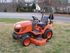 NICE KUBOTA BX 2350 4 WHEEL DRIVE TRACTOR WITH 60 IN MID MOUNT MOWER - Bid Now! Only $6100.0