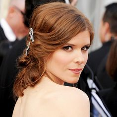 Kate Mara's soft, twisty chignon was topped off with a touch of sparkle.