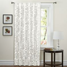 @Overstock.com - Lush Decor White 84-inch Lilian Curtain Panel - Add a modern touch to your windows with this elegant 84-inch curtain panel. Made from faux-silk polyester, the white panel features an intricate design and an easy-to-hang rod-pocket design. Finish the look with the included matching tiebacks.  http://www.overstock.com/Home-Garden/Lush-Decor-White-84-inch-Lilian-Curtain-Panel/6537422/product.html?CID=214117 $23.84