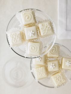 Bridal Collection_ Our Bridal collection adds a bit of formal elegance to the demure petits four. These square cakes are decorated with classic elements: hand-cut flowers, edible pearls, classic swirls and traditional harlequins. Flavors: Raspberry, Vanilla, Lemon