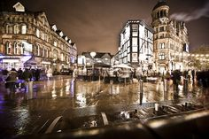 Manchester, UK. Lovely night time photo.  Great sepia tint on this one.