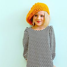 Love the slouchy hat and chevron dress