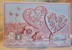 Pretty Pink Paper Scraps: Valentine 's Spellbinders Vines of Passion, Spellbinders Classic Petals Edgeabilities, Spellbinders Opulent Ovals, flowers from Wild Orchid Crafts, Memory Box Leaf Flourish, Cuttlebug Polka Dot embossing folder, butterfly punch, a bit of ribbon with a faux rhinestone buckle and some pearls.