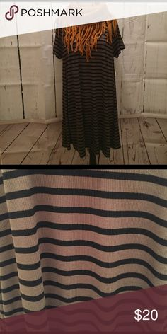 NWT Olive Green & Black Stripe Ribbed Swing Dress I love this olive color dress. It looks great with black ankle boots (for sale in my closet) with black tights or no tights or add some wedges or sandals for a more dressy look. This scarf (for sale in my closet) adds some color to this outfit. Message me if you have questions. I offer a discount when you add items in a bundle. ✔️ Old Navy Dresses