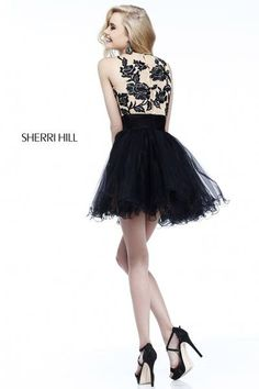 The top of this short sherri hill dress is so fab !