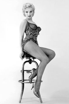Balancing on a stool for a publicity portrait for Bus Stop in Los Angeles, 1956.