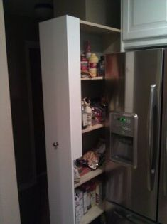 DIY pull out pantry to go in wasted space next to refrigerator - using Ikea bookcase as a base, casters
