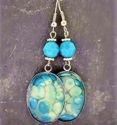 Hung from sterling silver ear wires these earrings feature hand painted bezels in Silver and Bright Blue and measure approx. inches in length. (They also feature Swarovski Crystal bead and elements in complimentary tones. Earrings Handmade, Handmade Jewelry, Handmade Items, Burnley, Swarovski Crystal Beads, Jewelry Collection, Turquoise Necklace, Jewelry Making, Hand Painted
