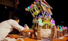 Chefs finalizing the Haunted Mansion Holiday gingerbread house at Disneyland.