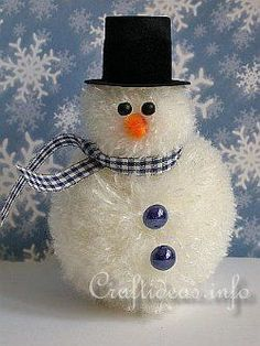 Everyone who sees this Fuzzy Yarn Snowman is sure to fall in love! With beads and yarn, you can create an adorable Christmas character who's as soft as pom poms. Bring the cute factor to your DIY Christmas decorations with this snowman craft..
