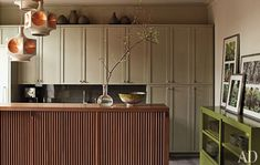 fabulous small kitchen. Island base opens to reveal storage and flat screen.