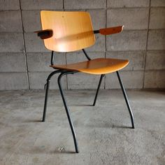 Kho Liang Ie; #315 Molded Plywood and Enameled Metal Armchair for Car Katwijk, 1950s.
