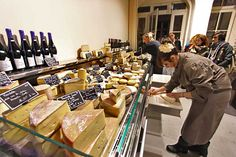 Harder cheeses are displayed in one case at Fromagerie Deruelle gourmet cheese shop in Bordeaux, France