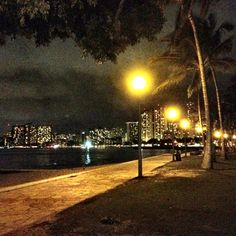 Waikiki at Night, Honolulu, Hawaii. I love the night lights and sound of the waves on the beach.