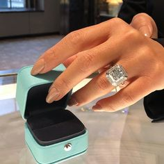 Tiffany & Co. 5.5CT fancy blue green rectangular modified brilliant diamond in this exquisite setting.