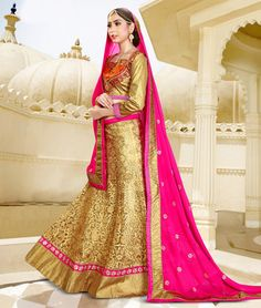 Beige embroidered net unstitched bridal lehengas at Mirraw.com