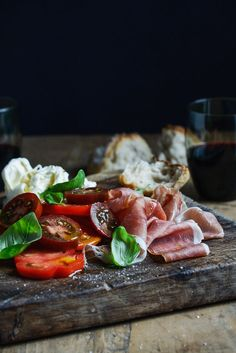 food52:  Always, forever.Heirloom Tomatoes with Prosciutto, Burrata and Basil via From the Kitchen