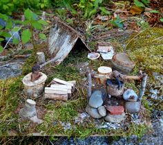 One of a kind Woodland Fairy Campsite. Magical forest camp handmade with natural materials found in the Maine woods including pine needles, moss, mushroom, pine cones, sticks, stones and other forest finds all mounted on reclaimed wood. It comes complete with attached mushroom table with stump stool, a cooking fireplace, chopping block with ax and firewood, fairy sleeping bag and tent. Enchanted woodland accessories for your fairy garden, miniature garden, terrarium or fairy house. The base…