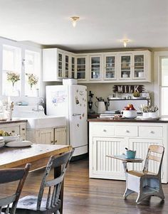 farmhouse kitchen- what a cute idea to keep the markers and homework off of the dining table