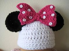 Crochet Minnie hat...there is no pattern but i think I can figure it out...dc or hdc for the main hat and tight sc rounds for the ears...the bow is about 3 or 5 rows of dc then scallop edges on the short sides then 5 buttons on each side of the tie in the middle... Easy peezy!