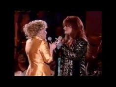 "Bette Midler and Wynonna Judd duet of ""The Rose"".  This song (just Bette Midler) was played at my best friends funeral....over 25 years ago.  Beautiful rendition."