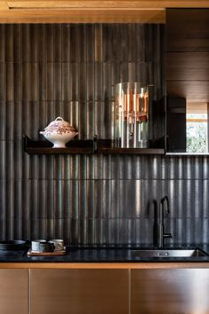 The founder of John Wardle Architects has remodelled Kew Residence, his Melbourne home of 25 years, using Victorian ash and handmade glazed tiles from Japan.