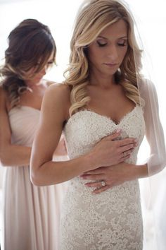 Beautiful lace wedding dress. And I love the down and curly hair!