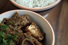 recipe for Kashmiri Gosht, a rich, dark stew of lamb shoulder with bones in ginger and whole spices