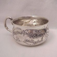 "Antique sterling silver baby cup, ""See Saw Margery Daw"" dated 1912."
