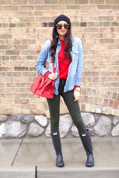 Shop this look for $115:  http://lookastic.com/women/looks/beanie-and-crew-neck-sweater-and-shirt-and-handbag-and-skinny-jeans-and-rain-boots/1403  — Black Beanie  — Red Crew-neck Sweater  — Light Blue Denim Shirt  — Red Leather Handbag  — Green Skinny Jeans  — Black Rain Boots