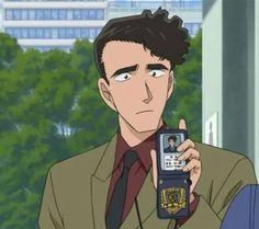 Inspector Shiratori shows his badge.
