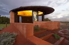 http://www.offgridquest.com/homes-dwellings/over-670-feet-of-rammed-earth-wall-made-