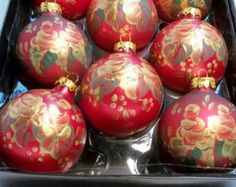 Hand-painted glass globe ornaments - gold roses on red