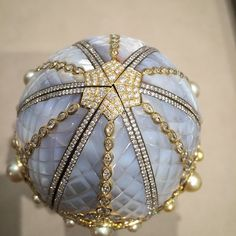 The amazing @faberge egg, the first made in 99 years, holds a special secret inside #baselworld #Faberge #fabergeegg  See more at www.thejewelleryeditor.com