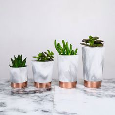 Copper dipped marbled black and white concrete pots  by sortcement