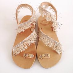 Leather sandals decorated with fringes in beige color. It is made by genuine Greek leather and decorated with light beige fringes giving them an ethnic, bohemian style. Crazy Shoes, Me Too Shoes, Leather Sandals, Shoes Sandals, Boho Wedding Shoes, Bohemian Sandals, Summer Shoes, Fashion Shoes, Footwear